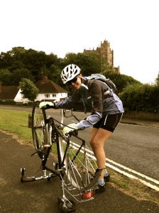 Louise waves her hands above the bike to fix the puncture!